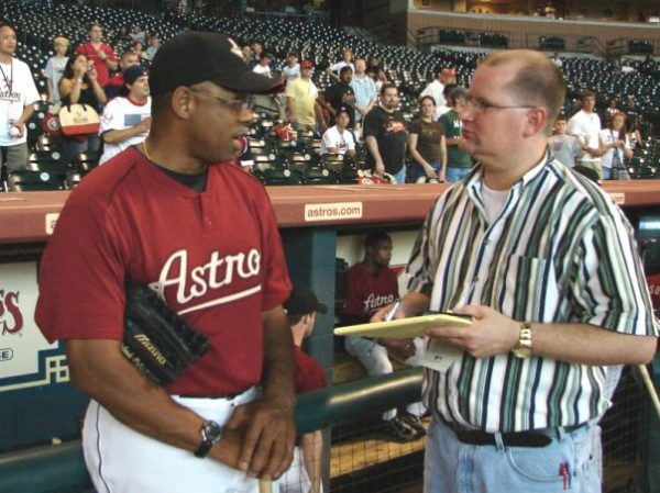 Astros coach Cecil Cooper talks with The Christian Chronicle's Bobby Ross Jr.
