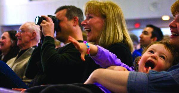 Greg and Mary Horton enjoy a laugh during the final chapel assembly at the Eastside Church of Christ in Portland, Ore. The girl is Ariel Howarth, daughter of Pearl Howarth, Cascade College's director of alumni relations.