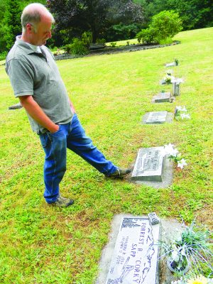 Brian Leavitt visits the church-owned cemetery.