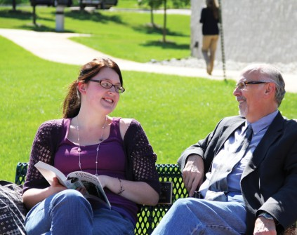 CAMPUS CHAT : Recent Rochester College graduate Emily Polet talks with psychology professor Gordon MacKinnon. | PHOTO BY ELLIOT JONES