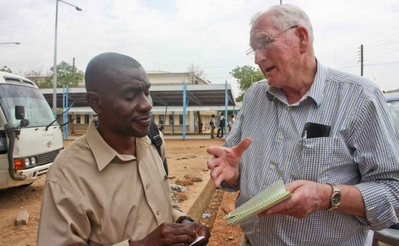 In 2011, Isaac Adotey, left, talks to Don Humphrey of The Sudan Project about the ministry's needs for soil data for South Sudan's Eastern Equatoria state.