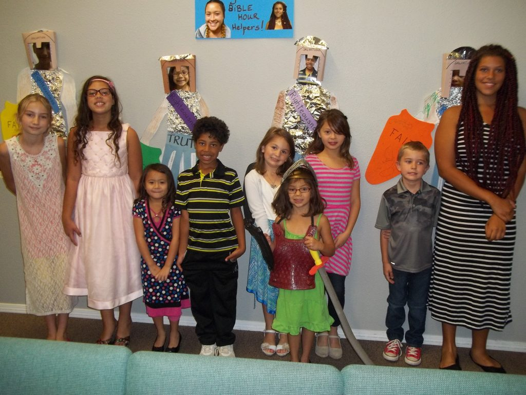 "Children at the Rio Rancho Church of Christ stand in front of their projects displaying the ""Armor of God."""