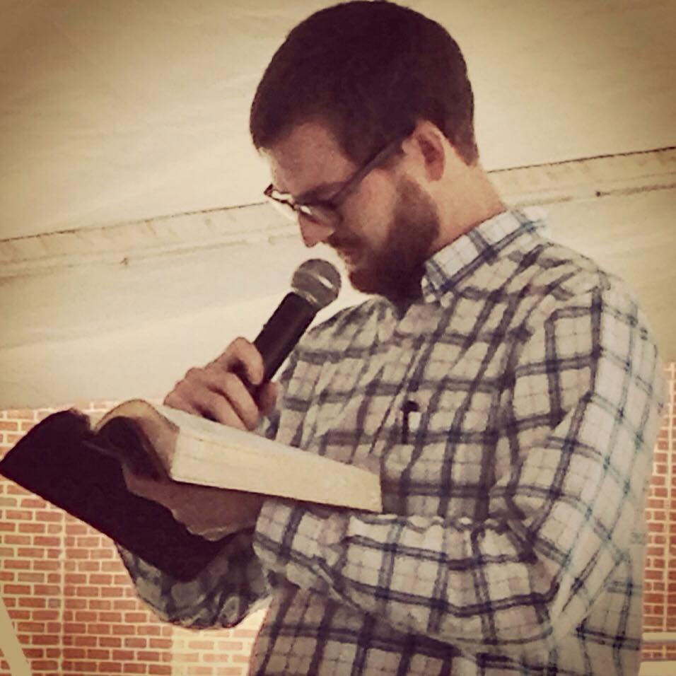 "Ebola survivor Dr. Kent Brantly reads from 2 Corinthians 1:3-11 at the ""Day of Hope"" at his home congregation"