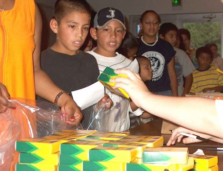Students line up for supplies at a giveaway sponsored by the South MacArthur Church of Christ in Irving