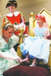 Rachel Bowen fits the magic glass slipper onto Sadie Gentry who was granted her wish to become a princess for the day by the North Rutherford church's youth group on Sunday. – Photo by Elisa Fisk