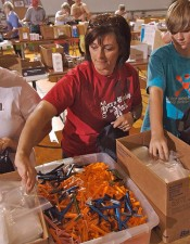 Madison Church of Christ member Tonya Billingsley puts several items into a baggie and backpack for use by soldiers of the 506th Brigade Combat Team. The 506th was the recipient of Operation Dad