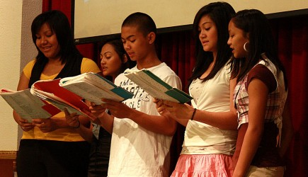 Teens sing devotional songs — all in English — during Sunday worship at the Cambodian church in Balch Springs