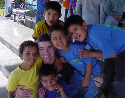 Jeff Fincher and a few of the young residents at the City of Children in Ensenada