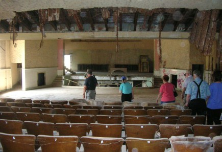 Alumni of Magic Valley Christian College tour the old auditorium at the campus