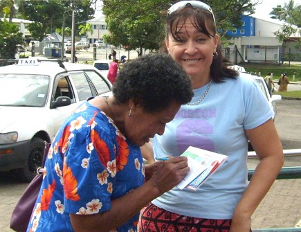 Jose Vatselias signs up one of her first students for a Bible correspondence course in Suva