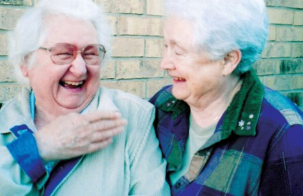 Retired librarians Winnie Bell and Erma Jean Loveland share a laugh. – (photo provided)