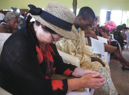 Joyce Anderson joins Nigerian Christians in prayer at the Kemta church in Abeokuta