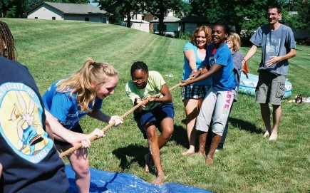 Teens from the Northtown church in Milwaukee play tug-of-war at a retreat. – (photo by John McAdams)