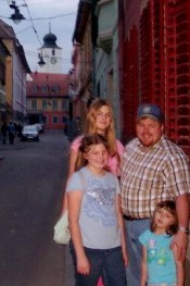 Lee Skelton and his daughters tour historic downtown Sibiu