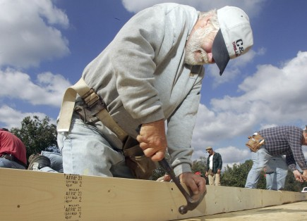 Tommy Davenport hammers a nail while working on the rebuilding of the Mount Zion church near Bowling Green