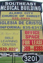 A sign outside the Southeast Medical Building in San Antonio marks the location for the Alamo City church. Twenty years after its beginnings as a home-based congregation