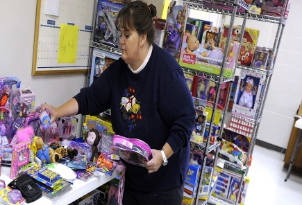 Volunteer Terri Simons sorts children's toys at a Christmas Store at the Highland church in Abilene
