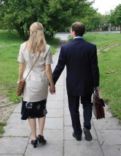 Daiva and Ilja Amosov walk to the Best Western hotel where the church in Vilnius