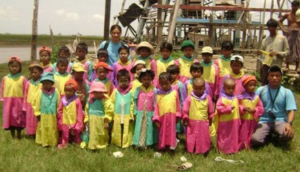 Schoolchildren in Myanmar show off their ponchos. – (photo provided)
