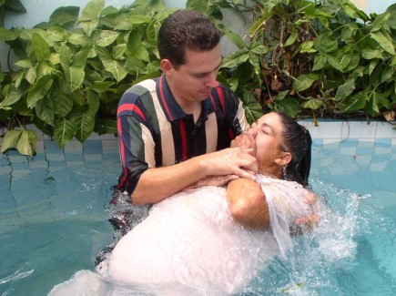Tony Fernandez performs one of 21 baptisms on a recent Sunday in Matanzas
