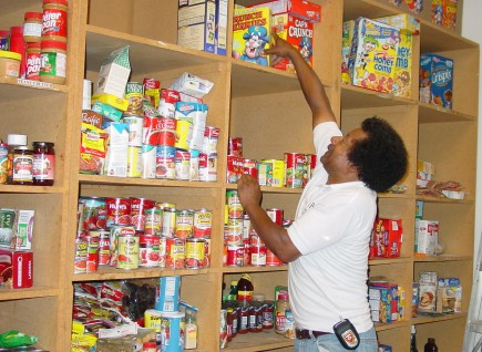 Carl Jemison Jr. stocks the food pantry at the Overland Park