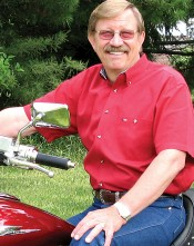Evangelist Larry West sits on his 2003 Honda VTX 1800 motorcycle. – (photo provided)
