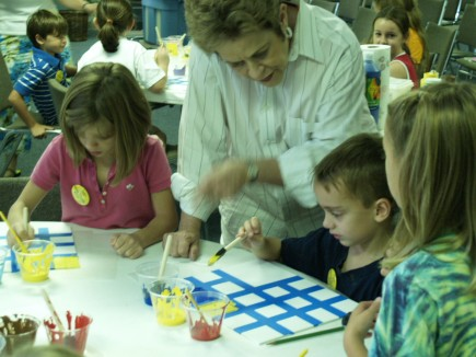 Young artists paint a detailed project at the Kingwood Church of Christ's Art Camp in 2008. This year
