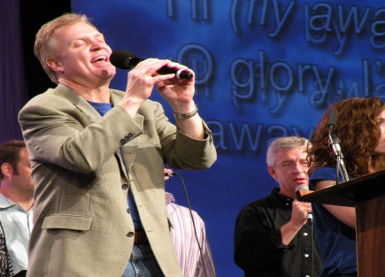 "Ken Young leads the classic song ""I'll Fly Away"" during worship in Nashville"