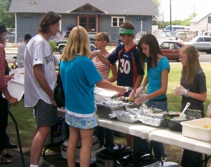Members of the youth group at the University church in Denver feed homeless and poor residents of Grand Junction