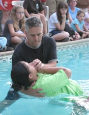 Mike Avedikian baptizes Mariah Bishel at Yosemite Bible Camp in California. – PHOTO BY ERIN CLIFF