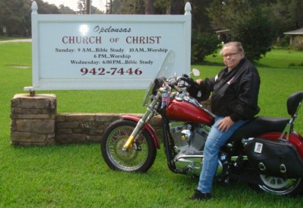 Evangelist Clarence Holmes rides a Harley. – (Photo by Guy Bozeman)