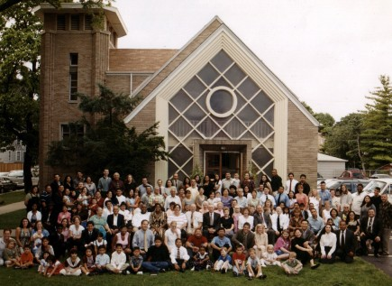 Members of the Northwest church gather for a group photo outside the building in a residential neighborhood filled with Chicago-style bungalows. – PHOTO COURTESY OF ZUNO PHOTOGRAPHIC STUDIO