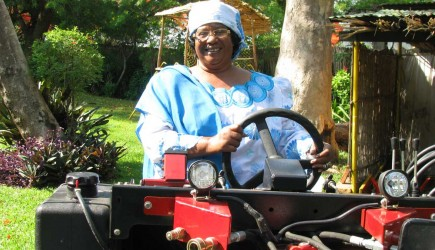 Malawi Vice President Joyce Banda tries out a Village Tractor