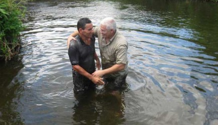 Edelto Villa baptizes a new believer near the historic city of Santa Clara