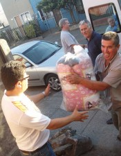 Church members unload relief supplies in Chiguayante