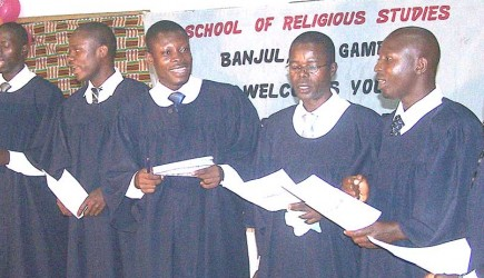 Students sing hymns during a graduation service at the School of Religious Studies in Banjul