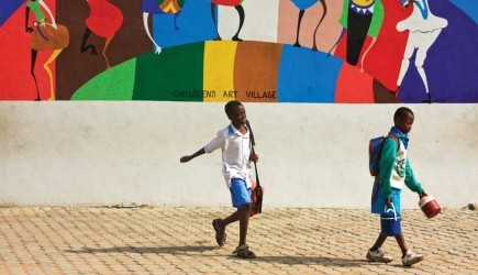 Students walk through the Children's Art Village plaza outside Hope Christian Academy. In 2009