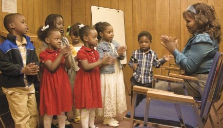 Glory Mensah leads children's worship time at the Church of Christ (Ghanaian Congregation) in Maryland. – PHOTO BY ERIK TRYGGESTAD