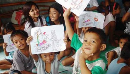 Children in the Philippines show off the pictures they colored during Vacation Bible School. – PHOTO PROVIDED BY RONNIE CARIAGA
