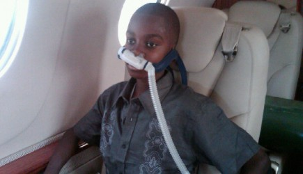 Using a machine to help him breathe