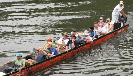Church members ride in a narrow boat on the Cayapas River in the South American nation of Ecuador. – PHOTO PROVIDED BY KENT MARCUM