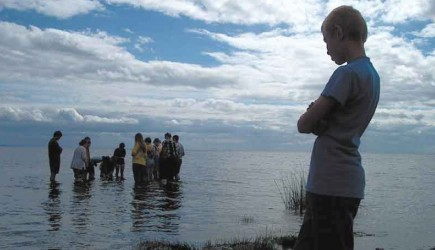 Russians and Americans witness a baptism at a youth camp near St. Petersburg