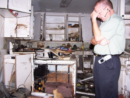 Fred Franke prays at a hurricane-damaged New Orleans home in 2005. – PHOTO BY BOBBY ROSS JR.