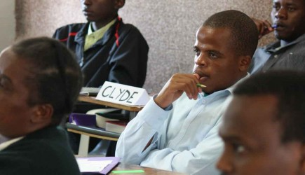 Moses K. Banda and fellow students at African Christian College in Swaziland listen during Ira Hill's class on project leadership. – PHOTO BY ERIK TRYGGESTAD