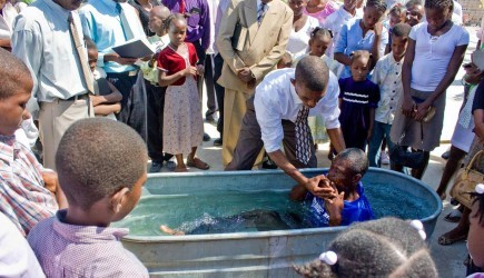 Thomas Widlord performs one of three baptisms after Sunday worship at the Santo Church of Christ near Port-au-Prince