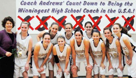 Leta Andrews and her Granbury High School Pirates stand in front of a chart counting down their victories. – PHOTO PROVIDED BY GRANBURY INDEPENDENT SCHOOL DISTRICT