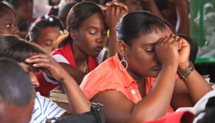 Christians pray during Sunday worship at the Delmas 28 Church of Christ in Port-au-Prince