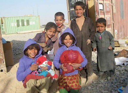 Children in Afghanistan's Helmand province -- the site of recent battles between U.S. forces and the Taliban -- smile with toys sent through the Lamia Afghan Foundation. John and Jan Bradley