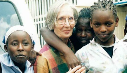 Dorothy Wright gets hugs from children with Made in the Streets in Kenya. Wright