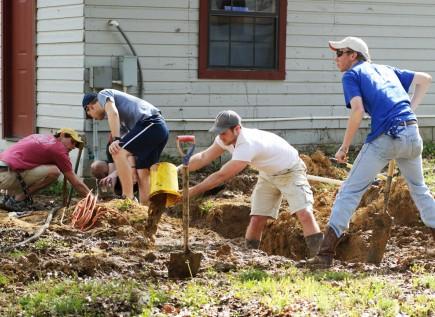 Harding University students repair a broken waterline at Camp Wyldewood